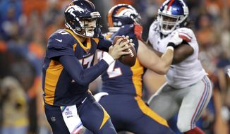 FILE - In this Sunday, Oct. 15, 2017 file photo, Denver Broncos quarterback Brock Osweiler scrambles during the first half of an NFL football game against the New York Giants in Denver. The Chiefs and Broncos appeared to be the class of the AFC West just a couple of weeks ago. They were a combined 8-1 to start the season. But they have combined to lose their last four games, and that has turned their Monday night, Oct. 30, 2017 showdown at Arrowhead Stadium into a matchup between teams desperate for a win. (AP Photo/Joe Mahoney, File)