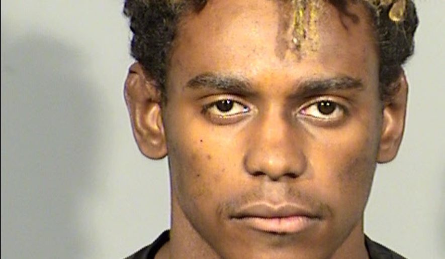 This undated Clark County Detention Center booking photo shows Juh'Juan Washington of Las Vegas. A judge on Wednesday, Oct. 25, 2017, set bail at $1 million for Washington after he was arrested and charged with gunpoint abductions last week of two women, including a UNLV student who told police he forced her to drive off campus and commit lewd acts against her. (Clark County Detention Center via AP)