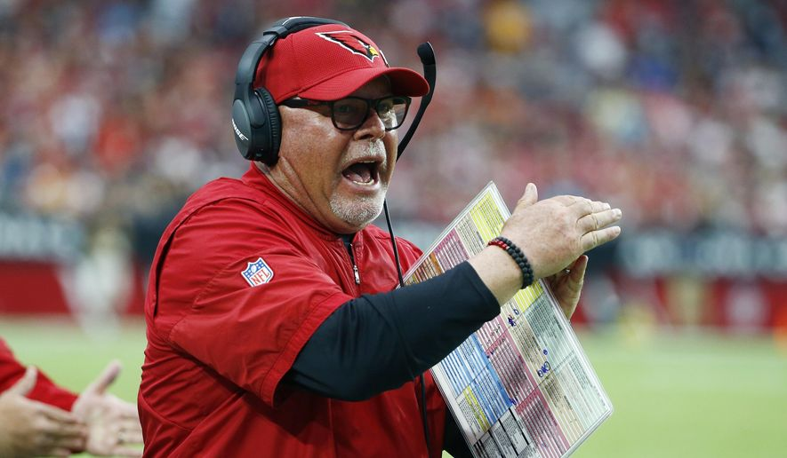 FILE - In this Oct. 15, 2017, file photo, Arizona Cardinals head coach Bruce Arians tries to call a timeout during the second half of an NFL football game against the Tampa Bay Buccaneers, in Glendale, Ariz.  As Arizona limps into its bye week at 3-4, the Cardinals have just lost quarterback Carson Palmer with a broken arm. (AP Photo/Ralph Freso, File) **FILE**