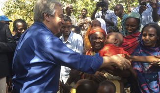 FILE- In this Wednesday, Oct. 25, 2017 file photo U.N. Secretary-General Antonio Guterres, left, shakes hands with people at Bangassou Cathedral Bangui, Central African Republic. Surrounded by hostile Christian militias, Muslim civilians in the volatile Central African Republic town of Bangassou have paid small fortunes to United Nations contractors to hide them in vehicles and take them to safety after U.N. peacekeepers repeatedly refused to do so, according to multiple people who made the journey. (AP Photo/Joel Kouam, File)