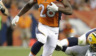 FILE - In this Aug. 26, 2017, file photo, Denver Broncos running back Jamaal Charles (28) runs with the ball against the Green Bay Packers during the first half of an NFL preseason football game in Denver. Charles envisioned playing his entire career with the Chiefs, retiring from the organization that drafted him. But the business of the NFL put a twist in those plans. Now their career rushing leader is returning to Kansas City with the rival Broncos for a crucial AFC West showdown Monday, Oct. 30. (AP Photo/Jack Dempsey, File)