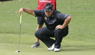 Kiradech Aphibarnrat of Thailand lines up his ball during the first round of the 2017 WGC-HSBC Champions golf tournament at the Sheshan International Golf Club in Shanghai, China Thursday, Oct. 26, 2017. Aphibarnrat is one of the leaders after the first round of competitions. (AP Photo/Ng Han Guan)