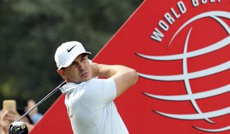 Brooks Koepka of the United States tee off during the first round of the 2017 WGC-HSBC Champions golf tournament at the Sheshan International Golf Club in Shanghai, China Thursday, Oct. 26, 2017. Koepka leads after the first round of the tournament. (AP Photo/Ng Han Guan)
