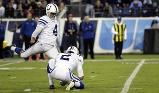FILE - In this Oct. 16, 2017, file photo, Indianapolis Colts kicker Adam Vinatieri (4) boots a field goal against the Tennessee Titans in the first half of an NFL football game in Nashville, Tenn. Rigoberto Sanchez (2) holds the ball. Vinatieri, the oldest, longest-tenured active player in the league and the last vestige of NFL Europe, still is not ready to hang up his cleats, not with so many items left on his to-do list. (AP Photo/James Kenney, File)