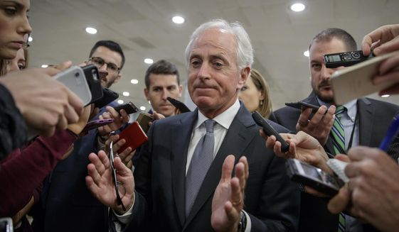 In this Oct. 25, 2017, file photo, Senate Foreign Relations Committee Chairman Bob Corker, R-Tenn., talks to reporters as he returns to his office from a vote, on Capitol Hill in Washington. (AP Photo/J. Scott Applewhite, File)