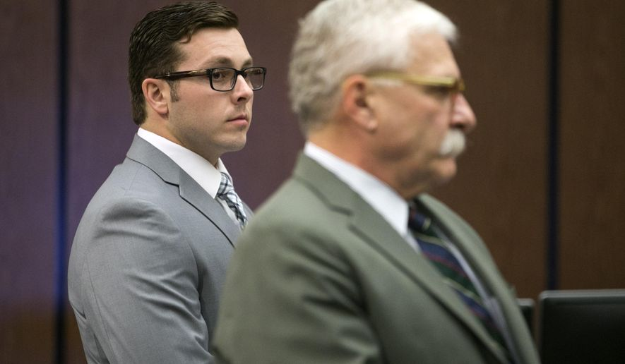 Former Mesa police officer Philip Brailsford, left, and his attorney, Mike Piccarreta, stand for the jury, at the start of Brailsford's murder trial at Maricopa County Superior Court in Phoenix, Wednesday, Oct. 25, 2017. Opening statements were postponed at Brailsford's murder trial in the fatal shooting of Daniel Shaver of Granbury, Texas, after his attorney asked a judge to forbid news organizations from broadcasting video of the deadly encounter. (David Wallace/The Arizona Republic via AP)