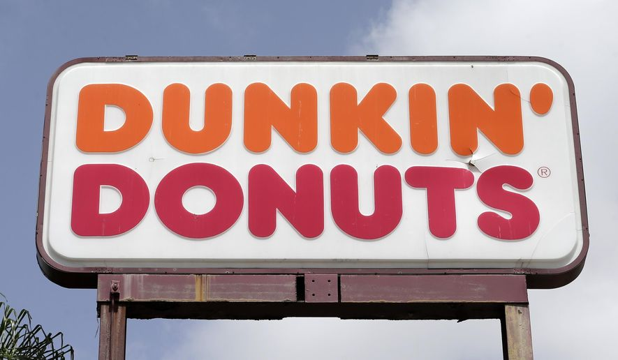 This Thursday, Aug. 3, 2017, photo shows a Dunkin' Donuts sign at a store in Hialeah, Fla. Dunkin' Brands Group, Inc. reports earnings Thursday, Oct. 26, 2017. (AP Photo/Alan Diaz)