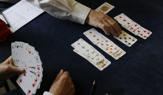 FILE - In this Sept. 22, 2015 file photo, competitors play bridge at the Acol Bridge Club in West Hampstead, London. The European Union's top court ruled Thursday, Oct. 26, 2017 that when it comes to taxes the game of bridge a is not a sport. (AP Photo/Tim Ireland, File)