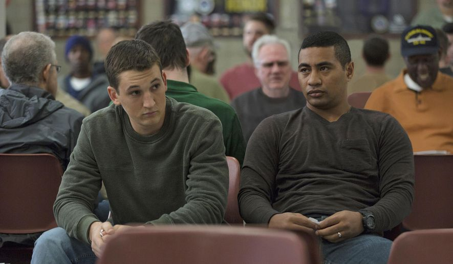 """This image released by DreamWorks Pictures shows Miles Teller, left, and Beulah Koale in a scene from,""""Thank You for Your Service."""" The drama follows a group of U.S. soldiers returning from Iraq who struggle to integrate back into family and civilian life. (Francois Duhamel/DreamWorks Pictures via AP)"""