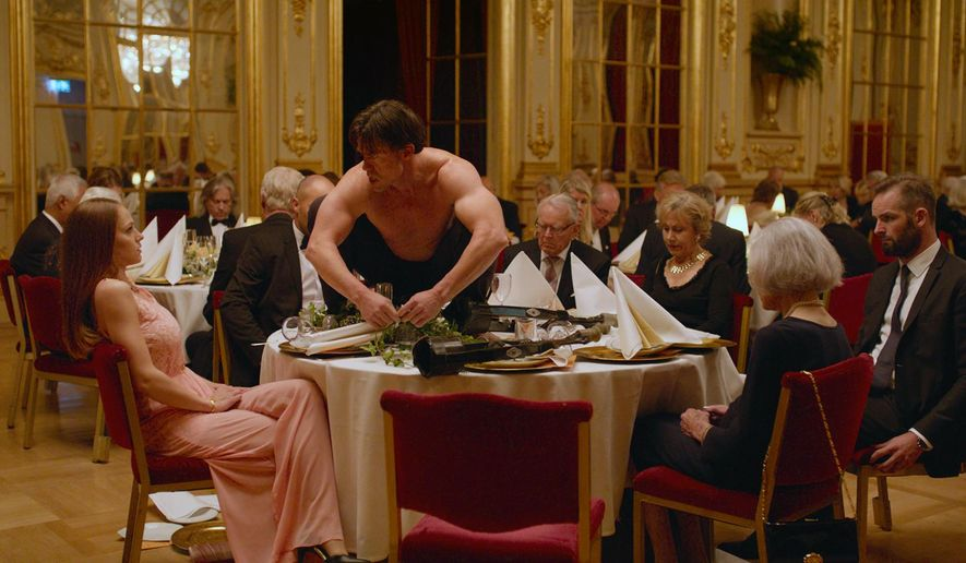 """This image released by Magnolia Pictures shows Terry Notary, center, in a scene from """"The Square.""""  (Magnolia Pictures via AP)"""