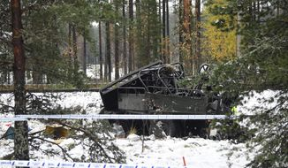The wreckage of a military truck lays by the side of the railway tracks after several people were killed in a crash with a train in southern Finland Thursday Oct. 26, 2017.  Finnish media say several people have been killed in a train crash in the southern part of Finland. (Markku Ulander/Lehtikuva via AP)