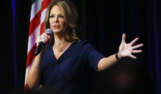 In a Tuesday, Oct. 17, 2017 photo, former Republican Arizona state Sen. Kelli Ward smiles as she is greeted by supporters at a campaign fundraiser, in Scottsdale, Ariz. Ward was expected to run against Republican U.S. Sen. Jeff Flake in the Arizona 2018 primary, but Flake has bowed out of a re-election, announcing his retirement on Tuesday. Flake's decision to bow out of a re-election fight could spur a rush of other Republican candidates who hope to take on his only announced challenger in the Arizona primary next year. (AP Photo/Ross D. Franklin)