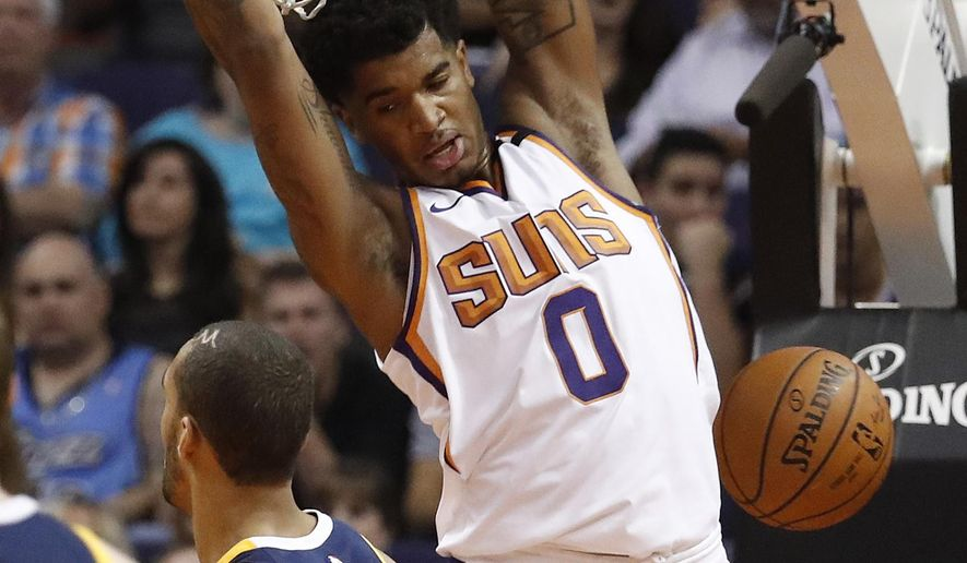 Phoenix Suns forward Marquese Chriss (0) dunks against the Utah Jazz during the first half of an NBA basketball game, Wednesday, Oct. 25, 2017, in Phoenix. (AP Photo/Matt York)