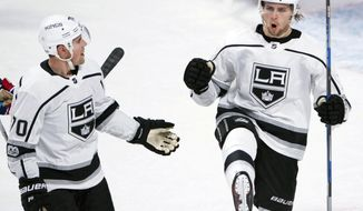 Los Angeles Kings left wing Adrian Kempe, right, celebrates his goal with teammate Tanner Pearson during the first period of an NHL hockey game against the Montreal Canadiens, Thursday, Oct. 26, 2017 in Montreal. (Ryan Remiorz/The Canadian Press via AP)