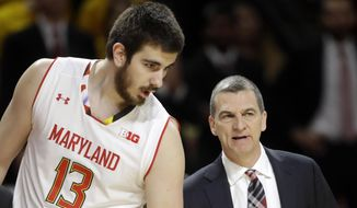 In this March 4, 2017, photo, Maryland forward Ivan Bender, left, of Bosnia and Herzegovina, speaks with head coach Mark Turgeon in the first half of an NCAA college basketball game against Michigan State in College Park, Md. The resurgence of the Maryland basketball program can be attributed in no small part to Melo Trimble, whose scoring and leadership helped the Terrapins make three straight trips to the NCAA Tournament. This season, Maryland intends to sustain that success without him. (AP Photo/Patrick Semansky) **FILE**
