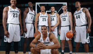 FILE - Wednesday, Oct. 11, 2017 file photo, Michigan State big men, at 6-foot-7 or taller, are shown during the NCAA college basketball team's media day in East Lansing, Mich. Shown are Miles Bridges, bottom, and back row from left, Xavier Tillman, Jaren Jackson, Kenny Goins, Gavin Schilling, Ben Carter and Nick Ward. Miles Bridges is back at Michigan State, turning down a chance to be a lottery pick. And, the Spartans are so stacked with talent a freshman teammate, Jaren Jackson, is projected by some to be picked before Bridges in the 2018 NBA draft. (AP Photo/Al Goldis, File)