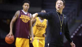 FILE - In this Sept. 29, 2017, file photo,  Minnesota men's basketball coach Richard Pitino leads NCAA college basketball practice in Minneapolis. The most anticipated season for Minnesota men's basketball in 20 years has begun. Coach Pitino's team, coming his first appearance with the program in the NCAA Tournament, is among the favorites this season for the Big Ten race. (Leila Navidi/Star Tribune via AP, File)
