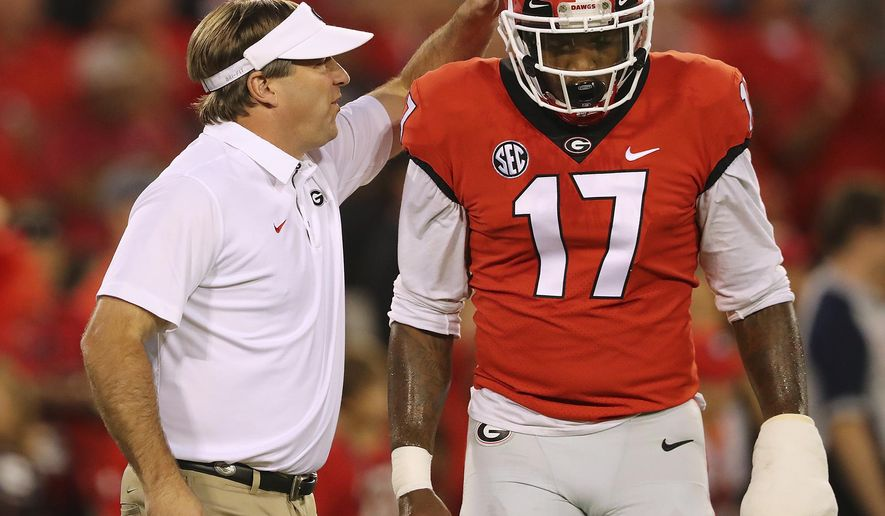 Georgia head coach Kirby Smart encourages linebacker Davin Bellamy as they prepare to play Missouri in an NCAA college football game, Saturday, Oct. 14, 2017, in Athens, Ga. (Curtis Compton/Atlanta Journal-Constitution via AP)