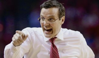 FILE- In this Feb. 9, 2017 file photo, Nebraska coach Tim Miles gestures during the first half of an NCAA college basketball game against Wisconsin in Lincoln, Neb. Miles says he's confident the Cornhuskers are better than what the prognosticators say. The media picked Nebraska to finish 13th out of 14 teams in the Big Ten. (AP Photo/Nati Harnik)