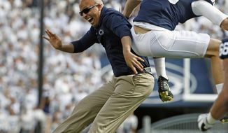 FILE - In this Sept. 9, 2017, file photo, Penn State head coach James Franklin, left, celebrates with tight end Mike Gesicki (88) after Gesicki scored a touchdown against Pittsburgh during the first half of an NCAA college football game in State College, Pa. In his fourth season as Penn State coach, James Franklin has the No. 2 team in the country. He has not just restored the pride in Penn State football to pre-Sandusky scandal levels, the Nittany Lions are playing as well as they did during Joe Paterno's prime.  (AP Photo/Chris Knight, File)