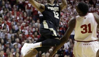 FILE - In this Feb. 9, 2017 file photo, Purdue's Vince Edwards shoots next to Indiana's Thomas Bryant during the first half of an NCAA college basketball game in Bloomington, Ind. (AP Photo/Darron Cummings, File)