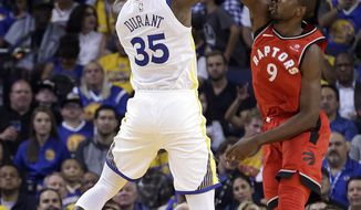 Golden State Warriors' Kevin Durant (35) shoots against Toronto Raptors' Serge Ibaka, right, during the first half of an NBA basketball game Wednesday, Oct. 25, 2017, in Oakland, Calif. (AP Photo/Ben Margot)