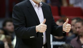 San Antonio Spurs head coach Gregg Popovich gestures during the second half of an NBA basketball game against the Miami Heat, Wednesday, Oct. 25, 2017, in Miami. The win was No. 1,154 for San Antonio coach Gregg Popovich, now one shy of matching Phil Jackson for sixth-most in NBA history. The Spurs defeated the Heat 117-100. (AP Photo/Wilfredo Lee)