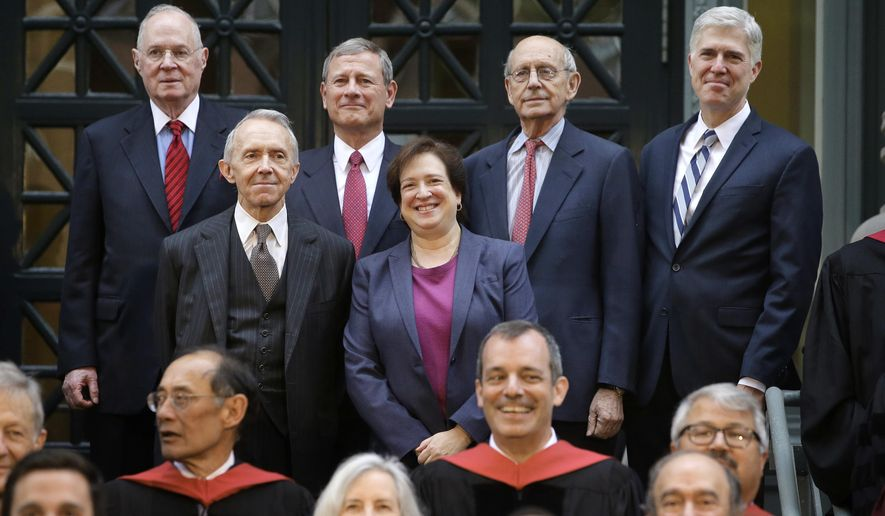 Justices of the U.S. Supreme Court, Associate Justice Elena Kagan, center right, and top row from left, Associate Justice Anthony Kennedy, Chief Justice John Roberts, Associate Justice Stephen Breyer, and Associate Justice Neil Gorsuch, stand for a photo with retired Associate Justice David Souter, center left, for a photograph Thursday, Oct. 26, 2017, at Harvard Law School on the campus of Harvard University in Cambridge, Mass. The Supreme Court Justices were at the school to open a bicentennial summit. (AP Photo/Steven Senne)