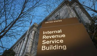 FILE -This April 13, 2014 file photo shows the headquarters of the Internal Revenue Service (IRS) in Washington. The Trump administration has settled lawsuits with dozens of tea party groups who said they received extra, often burdensome scrutiny when applying for tax-exempt status.  (AP Photo/J. David Ake, File)
