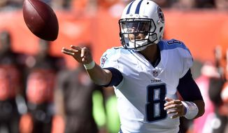 FILE - In this Sunday, Oct. 22, 2017, file photo, Tennessee Titans quarterback Marcus Mariota (8) passes the ball in the first half of an NFL football game against the Cleveland Browns in Cleveland. The Titans are spending their bye week trying to figure out how to rev up their offense as they chase their first AFC South title and playoff berth since 2008.(AP Photo/David Richard, File)