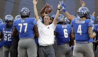 FILE - In this Saturday, Oct. 14, 2017, file photo, Memphis head coach Mike Norvell celebrates after defensive back Austin Hall intercepted a pass to seal a 30-27 upset win over Navy in the final minutes of the fourth quarter of an NCAA college football game in Memphis, Tenn. Norvell is trying to keep his Tigers focused on how much the Tulsa have improved this season. (AP Photo/Mark Humphrey, File)