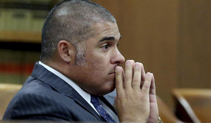 FILE - In this Oct 13, 2016 file photo, McLennan County District Attorney Abel Reyna looks on during a pretrial hearing involving the biker shoot out at Twin Peaks restaurant in Waco, Texas. Reyna, the Texas district attorney prosecuting bikers allegedly involved in a 2015 shooting with police in Waco, has asked to be recused from the case of a biker scheduled to stand trial Nov. 6. The biker, Matthew Clendennen, has alleged that Reyna is under federal investigation for selective prosecution for political gain. (Rod Aydelotte/Waco Tribune Herald, via AP, File)