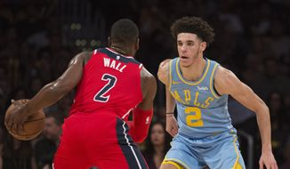Los Angeles Lakers guard Lonzo Ball, right, defends Washington Wizards guard John Wall during the second half of an NBA basketball game in Los Angeles, Wednesday, Oct. 25, 2017. (AP Photo/Kyusung Gong)