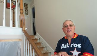"""In this Oct. 25, 2017 photo, Paul Daulong talks about how the Astros' trip to the World Series has helped him and his family focus on something positive as they continue rebuilding their Houston home after it was flooded during Hurricane Harvey. Daulong says he believes he and others who are recovering after Harvey will follow the example of the Astros, who went through their own recent rebuilding process after several losing seasons, and """"be back on top too."""" (AP Photo/Juan Lozano)"""