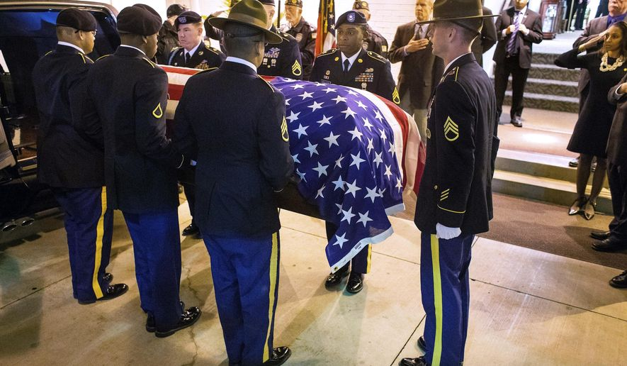 In this Oct. 25, 2017 photo, a Fort Leonard Wood Honors Team escorts the flag-draped casket with the remains of Army Staff Sgt. Michael Aiello into Staab Funeral Home in Springfield, Ill. Aiello went missing Sept. 30 1944, during intense fighting near the bridge at Nijmegen in the Netherlands. About eight years ago, the military disinterred a set of remains that were later identified as Aiello. Family members in the Springfield area provided DNA samples to confirm the identity and arrangements were made to transport the remains back to Springfield this week. (Ted Schurter /The State Journal-Register via AP)