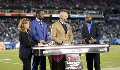 ESPN commentators broadcast from Nissan Stadium during an NFL football game between the Tennessee Titans and the Indianapolis Colts Monday, Oct. 16, 2017, in Nashville, Tenn. (AP Photo/Mark Zaleski)