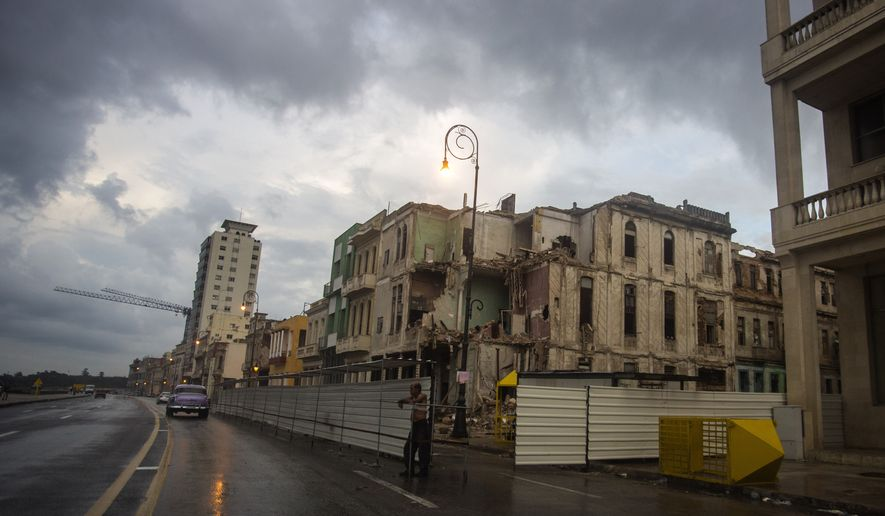 In this Oct. 12, 2017, file photo, a building is demolished on the Malecon in Havana, Cuba. (AP Photo/Desmond Boylan) ** FILE **