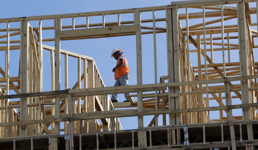 In this Friday, Oct. 6, 2017, file photo, workers build an apartment and retail complex in Nashville, Tenn. (AP Photo/Mark Humphrey) ** FILE **
