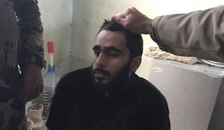 In this file photo provided by the U.S. District Court, Alexandria, Va., Mohamad Khweis, 27, of Alexandria, Va., is seen. Khweis, 27, the only American citizen to be convicted in a U.S. jury trial of successfully joining the Islamic State overseas, was sentenced to 20 years in prison Friday, Octr. 27, 2017. (U.S. District Court, Alexandria, Va. via AP, File)