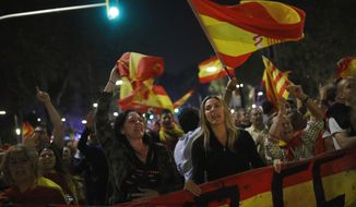 Anti-independence supporters shout slogans and wave Spanish flags as they march against the unilateral declaration of independence approved earlier by the Catalan parliament in downtown Barcelona Friday, Oct. 27, 2017. Catalonia's regional parliament passed a motion with which they say they are establishing an independent Catalan Republic.(AP Photo/Francisco Seco)