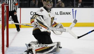 Vegas Golden Knights goalie Oscar Dansk blocks a shot by the Colorado Avalanche during the third period of an NHL hockey game Friday, Oct. 27, 2017, in Las Vegas. (AP Photo/John Locher)