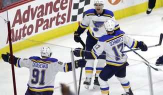 St. Louis Blues' Brayden Schenn (10) celebrates his goal with Vladimir Tarasenko (91), of Russia, and Jaden Schwartz (17) during the third period of an NHL hockey game against the Carolina Hurricanes in Raleigh, N.C., Friday, Oct. 27, 2017. St. Louis won 2-1. (AP Photo/Gerry Broome)