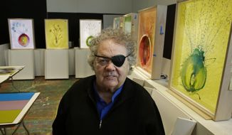 "FILE--In this March 23, 2017, file photo, glass artist Dale Chihuly poses for a photo in front of several of his ""Glass on Glass"" pieces in one of his studios in Seattle. A federal judge has disqualified well-known Seattle attorney Anne Bremner and her law firm from representing a man who says Chihuly failed to credit him for artistic contributions. (AP Photo/Ted S. Warren, file)"
