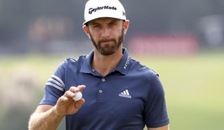 World number one golfer Dustin Johnson of United States reacts after finishing a hole during the first round of the 2017 WGC-HSBC Champions golf tournament at the Sheshan International Golf Club in Shanghai, China Thursday, Oct. 26, 2017. (AP Photo/Ng Han Guan)