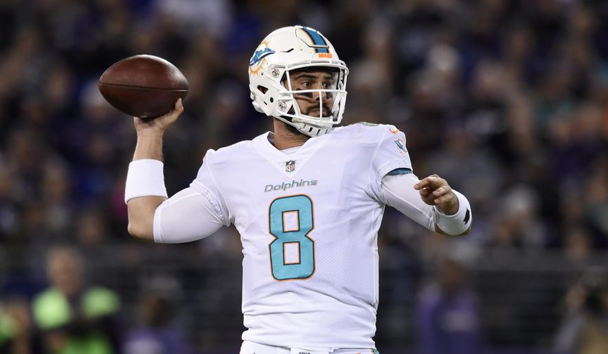 Miami Dolphins quarterback Matt Moore throws to a receiver in the first half of an NFL football game against the Baltimore Ravens, Thursday, Oct. 26, 2017, in Baltimore. (AP Photo/Gail Burton)
