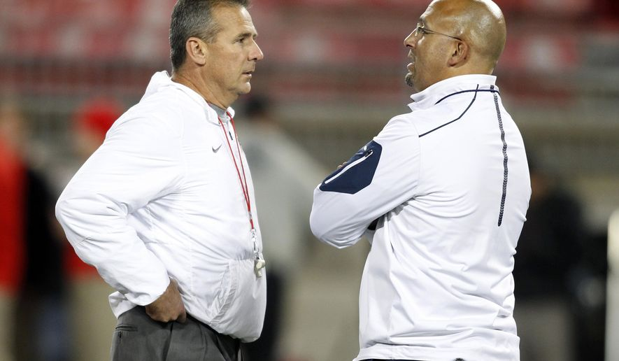 FILE - In this Oct. 17, 2015, file photo, Ohio State head coach Urban Meyer, left, and Penn State head coach James Franklin meet on the field before an NCAA college football game in Columbus, Ohio. No. 6 Ohio State will try to keep its playoff hopes alive by gaining revenge against No. 2 Penn State to highlight the ninth week of the college football season. (AP Photo/Paul Vernon, File)