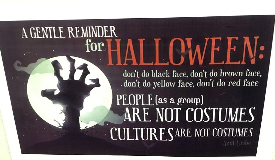 This Thursday, Oct. 26, 2017 photo shows a poster displayed on the University of New Hampshire campus in Durham, N.H., to encourage students avoid Halloween costumes that can be seen as racially or culturally offensive. Administrators at some universities across the country are increasingly concerned that certain costumes are becoming flash points in the campus debate over race and culture. (AP Photo/Michael Casey)