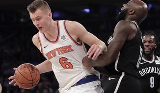 New York Knicks forward Kristaps Porzingis (6) drives the lane against Brooklyn Nets forward Quincy Acy (13) during the second quarter of an NBA basketball game, Friday, Oct. 27, 2017, in New York. (AP Photo/Julie Jacobson)