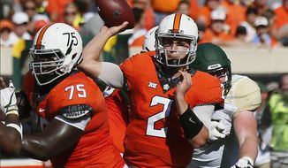 FILE - In this Saturday, Oct. 14, 2017, file photo, Oklahoma State quarterback Mason Rudolph (2) passes in the second quarter of an NCAA college football game against Baylor in Stillwater, Okla. Rudolph is the nation's passing yardage leader and will look to beat West Virginia for the third straight year when the 11th-ranked Cowboys play the 22nd-ranked Mountaineers on Saturday. (AP Photo/Sue Ogrocki, File)