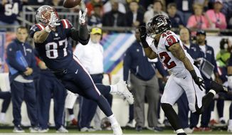 FILE - In this Oct. 22, 2017, file photo, New England Patriots tight end Rob Gronkowski (87) catches a pass in front of Atlanta Falcons linebacker Duke Riley (42) during the first half of an NFL football game in Foxborough, Mass. The play was nullified on an offensive pass interference penalty by Gronkowski. Tight end, not too long ago almost an afterthought for many teams, has become a critical spoke in the offensive wheel. (AP Photo/Steven Senne, File)